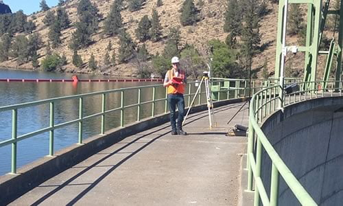 Male engineer carrying out survey outdoors on a dam in USA using the Routescene LidarPod.