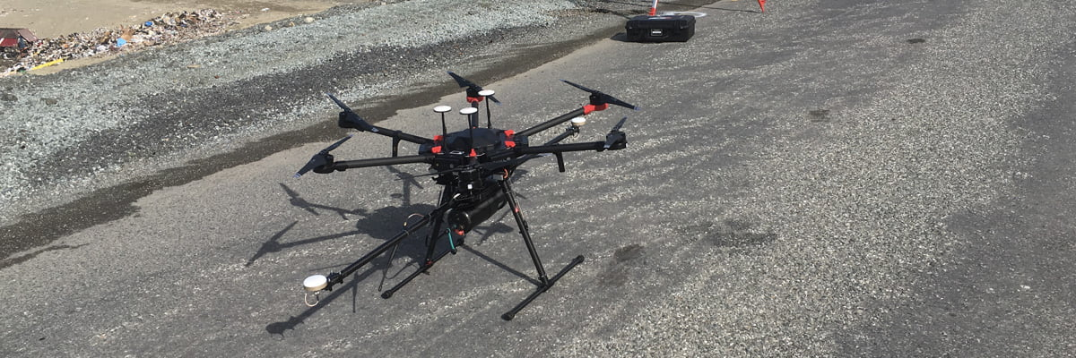 Routescene LidarPod integrated on a multicopter drone, on the ground ready for take off.