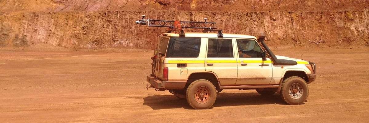 Truck mounted with Routescene vehicle LiDAR system surveying in an open cast mine in Australia.