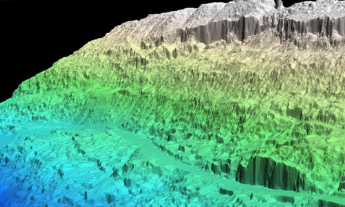 Blue, green and grey point cloud of a steep slope to highlight a landslide location and assess severity and impact.