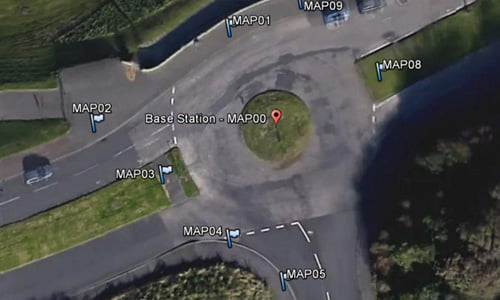 Aerial image of a roundabout with four exits and cars driving, to map location of base station and control points.