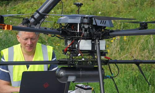 Male surveyor and founder of Routescene on site assisting with customer project,setting up UAV and LidarPod.
